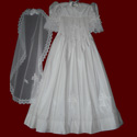 Click to Enlarge Picture - Hand Smocked Communion Dress With Embroidered Hail Mary Prayer & Crosses